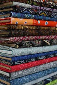 Seragam batik dalam wujud masih kain untuk seragam sekolah, kantor atau